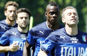 "Italy's Mario Balotelli, second from right, warms up with teammates Antonio Cassano, left, Giuseppe Rossi, second from left, and Claudio Marchisio during a training session in Coverciano training complex, in Florence, Italy, Wednesday, May 21, 2014. Police have had to intervene after Mario Balotelli was subjected to racist chants at Italy's World Cup training base. A few kids outside the Coverciano complex were responsible for the chants, and Balotelli appeared visibly disturbed. The training session was open to media and Balotelli could be heard saying as he ran by reporters, ""Only in Rome and Florence are they that stupid."" While most of the fans cheered for Balotelli, police approached the area where the chants came from and they quickly ended. Balotelli was born in Sicily to Ghanaian immigrants and brought up by an Italian foster family. He has faced racist chants throughout his professional career. (AP Photo/Fabrizio Giovannozzi)"